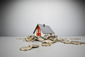 Toy house and Euro coins