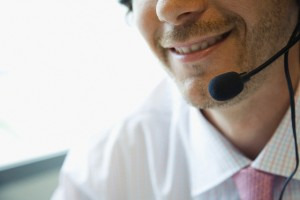 Office Worker Using Telephone Headset